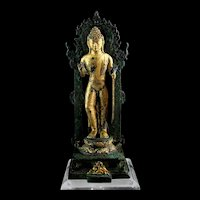 Exceptional standing Gilt bronze figure of Buddha, ca. 11th. cent