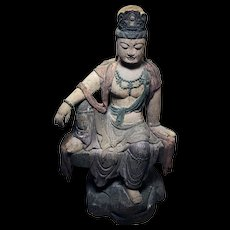 Massive Chinese wooden Guanyin seated in royal ease on rocks!