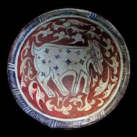 Rare large Islamic pottery bowl with goat, Kashan, 11th.-12th. cent.