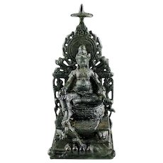Superb Hindu bronze figure of Kuvera, Javanese, ca. 10th. cent