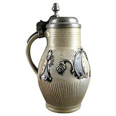 Rare intact fluted stoneware jug, Germany,  Muskau, 18th. century.