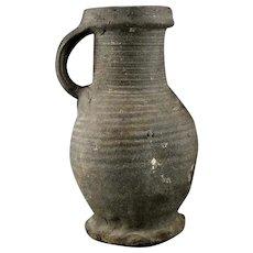 A rare greyware Medieval Siegburg stoneware jug, 13/14. cent.
