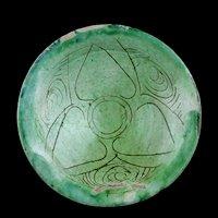 Superb carved Islamic dish w green glaze, Seljuqs, ca. 1100-1200 BC