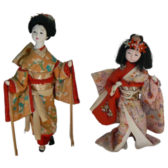 Vintage Oriental dolls original outfits and crushed oyster shell faces.