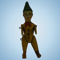 Very Early all wood tiny clown doll jointed arms and legs.