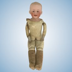 Cute Gebruder Heubach Smiling/grinning bisque shoulder head boy doll with leather jointed body.