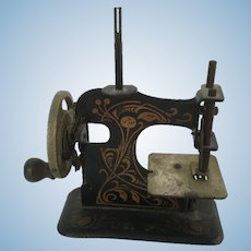 Early doll size or  small child size sewing machine very cute