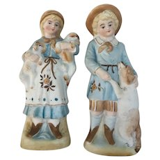 Old Pair of Boy and Girl holding dog n Puppies German made.