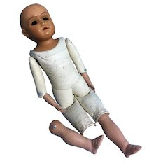 Old leather doll body with celluloid arms, lower legs n head.