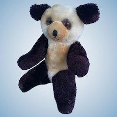 Vintage sitting panda teddy bear