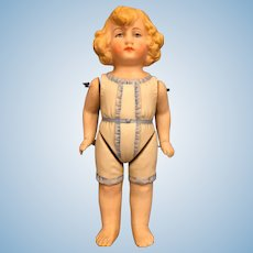 German all bisque doll molded cloths 5 inches tall.