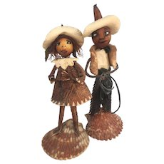 OLD sea shell and leather Cowboy n Cowgirl dolls