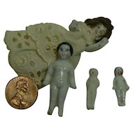 Group of frozen Charlotte dolls or china dolls tiny Look.