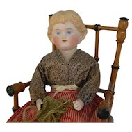 Parian type doll all original in old wood chair must see.