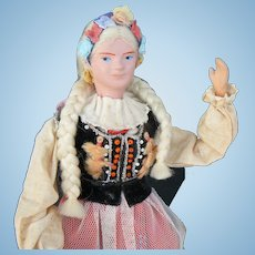 Vintage Polish Doll on stand and all original.