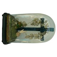 Very Very OLD Glass dome with Blue velvet cross and wax flowers and hand.