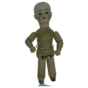 Darling Tiny Simon Halbig Bisque head doll Fully jointed body 9 inches tall TLC.