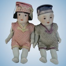 All bisque Japan Boy and Girl Dolls all original and sweet.