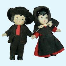 Vintage Amish all bisque dolls dressed pair