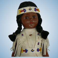 Vintage Hard Plastic Indian doll original leather outfit and Papoose on her back.