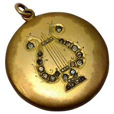 Antique Victorian gold filled rhinestone and seed pearl lyre instrument locket pendant