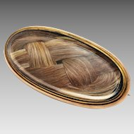 Antique Victorian 18k gold braided brunette hair under glass oval brooch pin