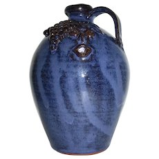 Jack T. Maness Southern Folk Art Pottery Face Jug with Tongue and Grapes (North Carolina)