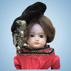 Antique Papermache doll. 12.3/4 tall.