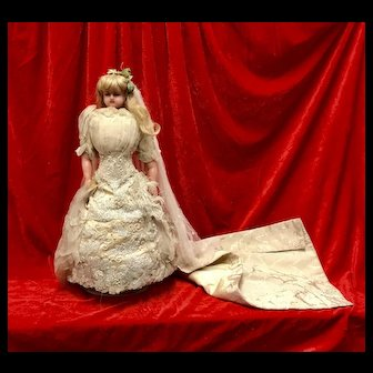Antique Poured wax doll in Wedding Dress.