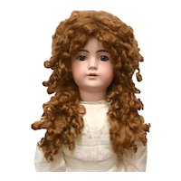 Global Bru Mohair tail wig in medium auburn