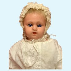 Antique wax over baby doll.18 Inches tall.