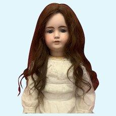 Antique brown human hair wig.