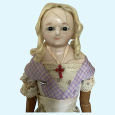 Antique  English slit head doll 20 inches tall.