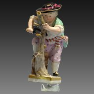 late 19th century Meissen Painted Porcelain Figure of Child Saw Wood-Cutter
