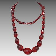 Cherry Amber/ Bakelite Faceted Beads