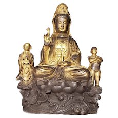 A Chinese Bronze Guanyin Group with Attendants