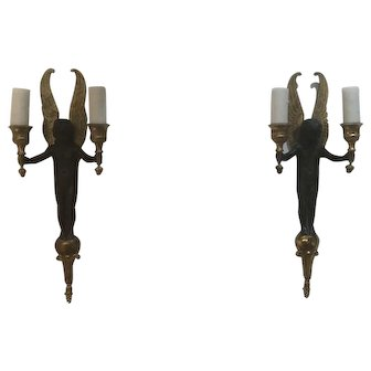 Pair of French Gilt and Patinated bronze Putti wall sconces