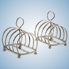 A Pair of English Sterling Silver Toast Racks