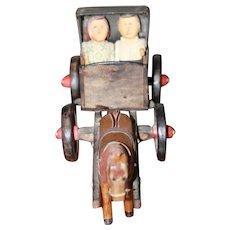 Poppets in HM Carriage Folk Art