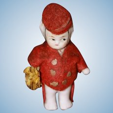 Miniature Bisque Bellhop (looking for a hotel)