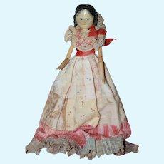 Antique Wood Doll w/ Dress of Many Colors