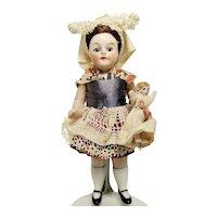 "Antique German Miniature 4"" Bisque Mignonette Doll"