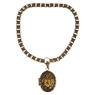 Victorian Pinchbeck Locket Pendant on a Link Chain England 19th century.