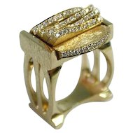 18 Karat White Gold & Diamond Kinetic Ring.