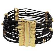 14 Karat Yellow Gold & Black Leather Black Diamond Bracelet.