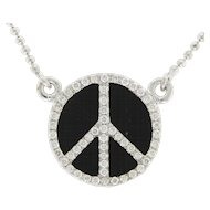 14 Karat White Gold Diamond and Black Onyx Peace Symbol Necklace.