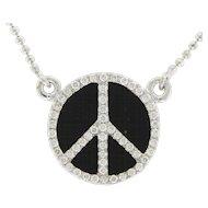 14 Karat White Gold Diamond and Black Onyx Peace Symbol Necklace.