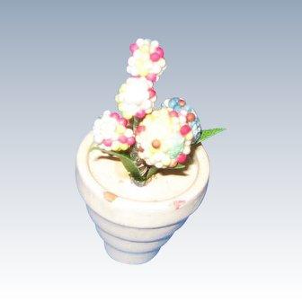Miniature flowers in wooden pot c 1920-30's