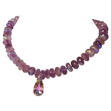 Amethyst AB rondelle beads with a Swarovski crystal tear drop pendent