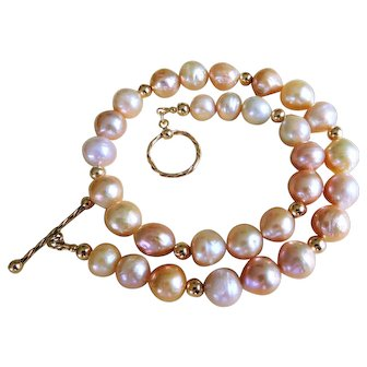 Baroque fresh water pearls and 14 K pure gold bead necklace